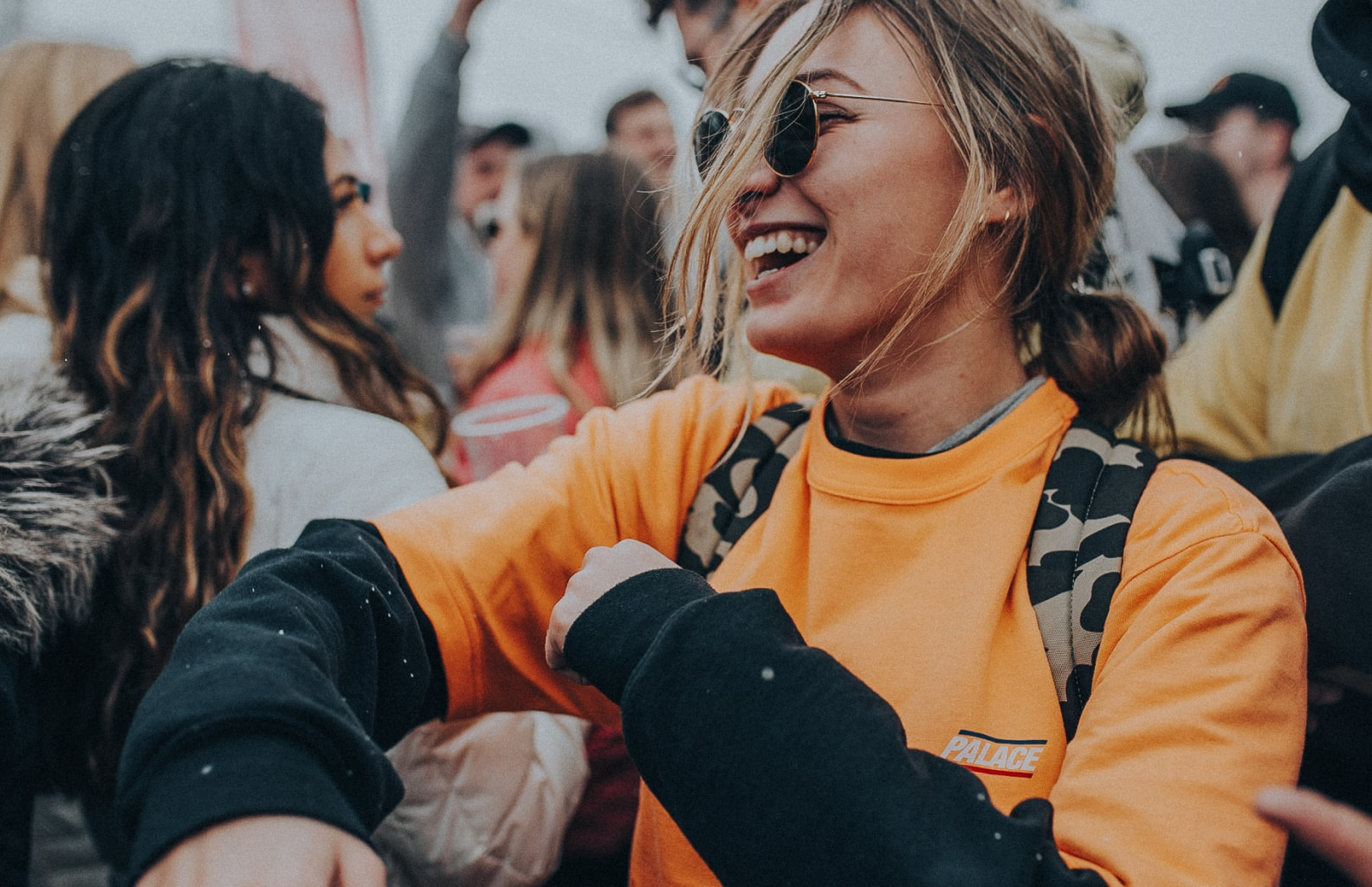 a girl smiling at a festival